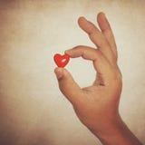 Corazón en finger foto de archivo libre de regalías