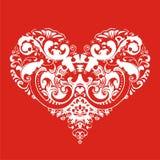 Corazón en fondo rojo Fotos de archivo