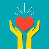 Corazón en icono de las manos Foto de archivo