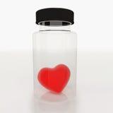 Corazón en la botella de cristal Foto de archivo libre de regalías