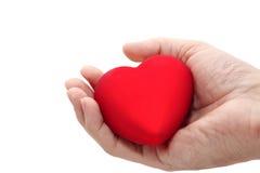 Corazón en la palma Imagenes de archivo
