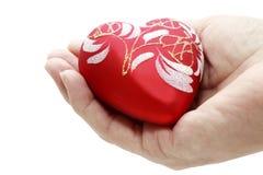 Corazón en la palma Imágenes de archivo libres de regalías