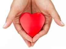 Corazón en la palma Fotos de archivo