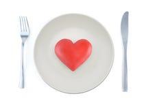 Corazón en la placa Fotografía de archivo libre de regalías