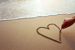 Corazón en la playa Foto de archivo