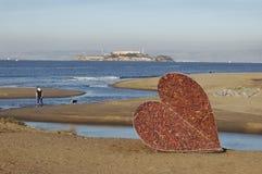 Corazón en la playa Fotos de archivo