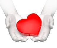 Corazón en manos Imagenes de archivo