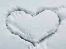 Corazón en nieve Fotos de archivo
