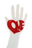 Corazón en silueta de la mano Fotos de archivo