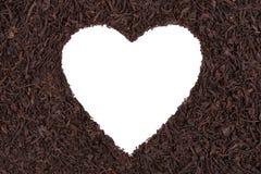 Corazón en un fondo del té Foto de archivo libre de regalías