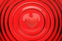 Corazón en un fondo rojo Fotos de archivo libres de regalías