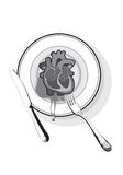 Corazón en un plato Imagenes de archivo