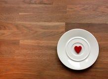 Corazón en una placa Imagen de archivo