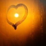 Corazón en ventana con el sol Fotos de archivo