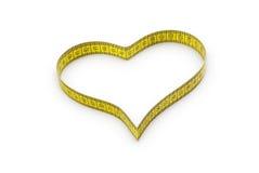 Corazón hecho de cinta métrica Foto de archivo