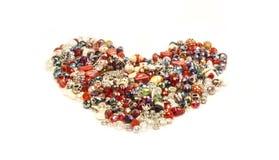Corazón hecho de la pequeña joyería Fotos de archivo libres de regalías