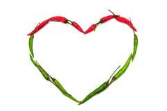 Corazón hecho de la pimienta de chile aislada en blanco Fotos de archivo libres de regalías