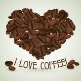 Corazón hecho de los granos de café con el texto abajo Imagenes de archivo