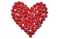 Corazón hecho fuera de cerezas fotografía de archivo
