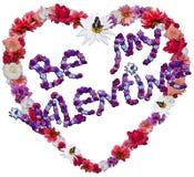 Corazón hermoso con la leyenda hecha de diversas flores Foto de archivo libre de regalías