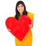 Corazón indio del rojo de la mujer imagen de archivo