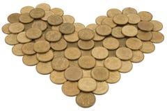 Corazón monetario Imagen de archivo libre de regalías