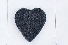 Corazón negro del caviar Foto de archivo libre de regalías