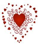 Corazón ornamental rizado rojo Foto de archivo libre de regalías
