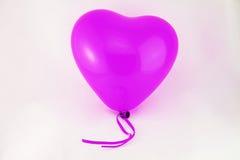 Corazón púrpura del globo Fotos de archivo