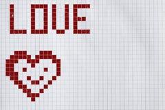 Corazón pintado en un trozo de papel de un cuaderno en una jaula fotografía de archivo libre de regalías