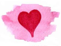 Corazón pintado sobre mancha de la acuarela Imagen de archivo