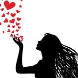 Corazón que sopla de la mujer de la silueta stock de ilustración