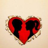 Corazón rasgado papel con las siluetas Foto de archivo