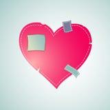 Corazón remendado con el hilo cosido Imagen de archivo