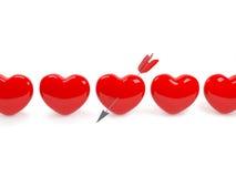 Corazón rojo aislado perforado por Arrow Fotografía de archivo libre de regalías