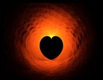 Corazón rojo ardiente en fondo negro Imagen de archivo