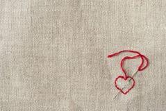 Corazón rojo bordado Imagen de archivo