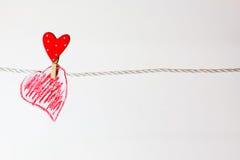 corazón rojo colgado Fotografía de archivo libre de regalías