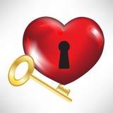 Corazón rojo con clave Foto de archivo
