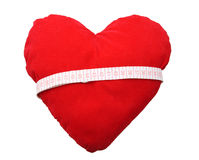 Corazón rojo con la cinta Fotos de archivo