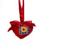 Corazón rojo de la tela imagenes de archivo