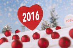 Corazón rojo de la tela con Feliz Año Nuevo Imagen de archivo libre de regalías