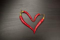 Corazón rojo de los chiles Foto de archivo libre de regalías