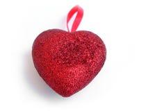 Corazón rojo de textura en el fondo blanco Fotos de archivo