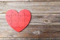 Corazón rojo del rompecabezas Fotografía de archivo