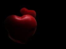 Corazón rojo en fondo negro imagen de archivo