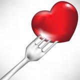 Corazón rojo en fork Foto de archivo libre de regalías