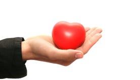 Corazón rojo en la mano Fotografía de archivo