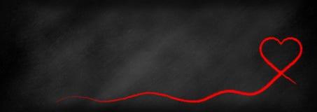 Corazón rojo en un backbround de la pizarra libre illustration