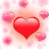 Corazón rojo en un fondo blanco con un bokeh rosado Fotografía de archivo libre de regalías